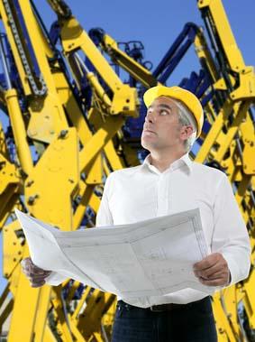 Senior businessman plan construction cranes